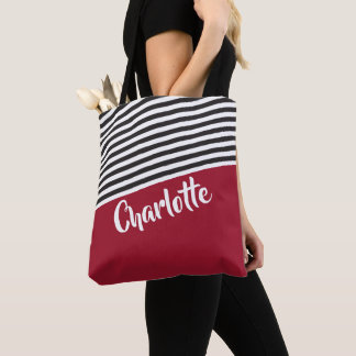 Roter Schwarz-weißer gestreiftes Tasche
