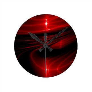 Roter schwarzer Strudel Runde Wanduhr