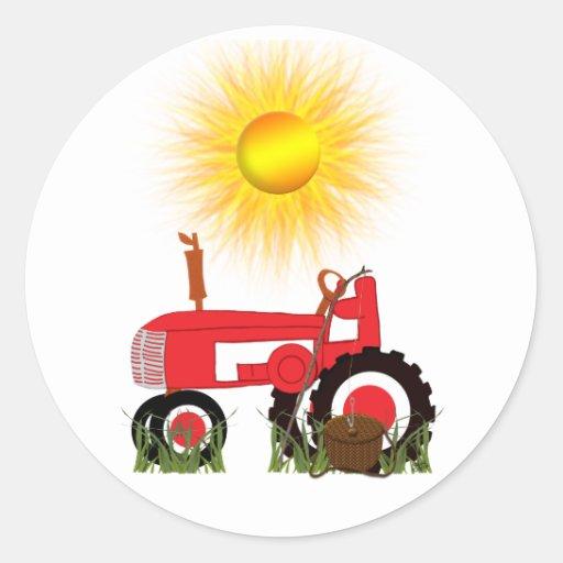 Roter Traktor mit Aufkleber der Fischerei-Pole