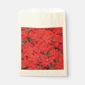 Roter Weihnachtsfeiertags-BlumenFoto der Geschenktütchen