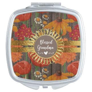 Rotes orange rustikales mit Blumenholz gesegnete Schminkspiegel