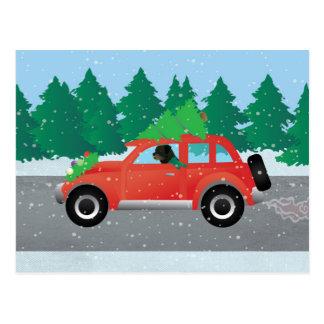 Rottweiler, das Weihnachtsauto fährt Postkarte