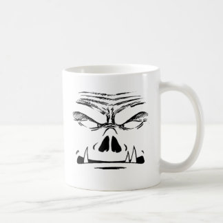 Rubbernorc stellen gegenüber kaffeetasse