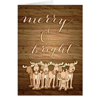 Rustikale hölzerne Weihnachtsgrußkarte fröhlich u. Karte