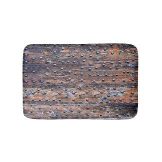 Rustikales altes verwittertes Holz mit Nägeln Badematte
