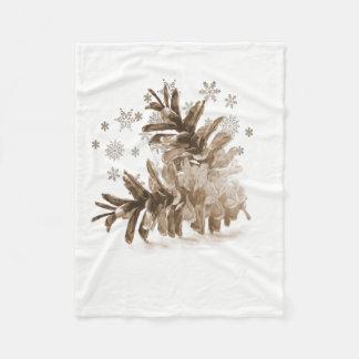 Rustikales Pinecones in der Schnee-Fleece-Decke Fleecedecke
