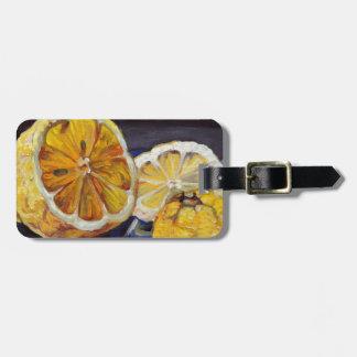 Saftige scharfe Zitrone halb Gepäckanhänger