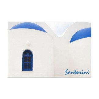 Santorini - eine kleine weiße Kirche mit blauen Leinwanddruck