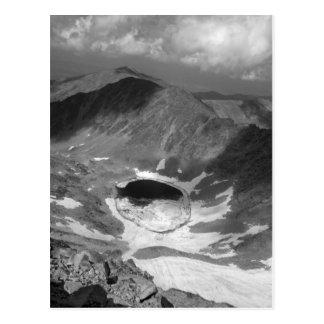 Schatten auf dem Bergabhang Postkarte