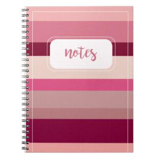 Schatten des rosa gestreiften Notizbuches Spiral Notizblock