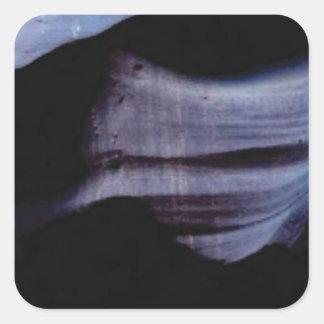 Schatten in der Felsenwand Quadratischer Aufkleber