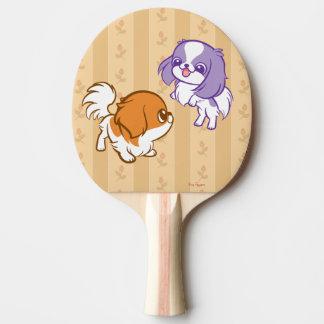 Scherzender Kawaii Welpen-Japaner Chin Tischtennis Schläger