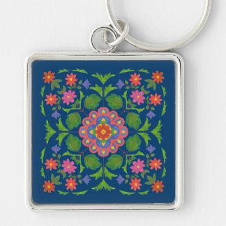 Schickes BlumenRangoli auf tiefem blauem Schlüsselanhänger