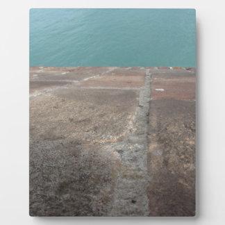 Schieben in das blaue Meer Fotoplatte