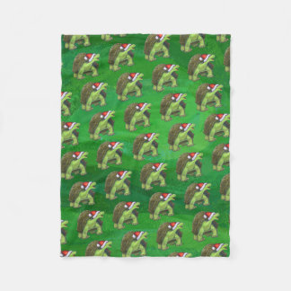 Schildkröte in der Weihnachtsmannmütze auf Grün Fleecedecke
