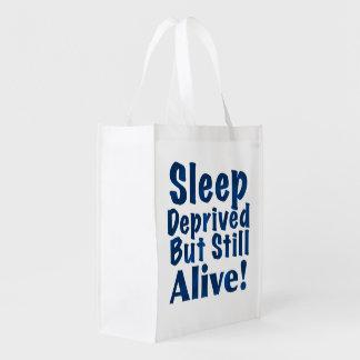 Schlaf beraubt aber noch lebendig in dunkelblauem wiederverwendbare einkaufstasche