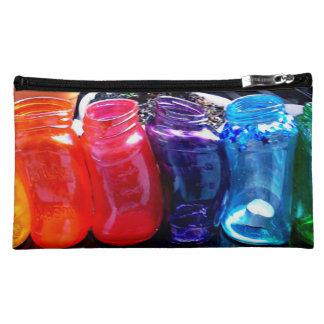 Schmelzender Regenbogen rüttelt kosmetische Tasche
