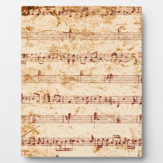 Schmutzklavier merkt Musikblatt Fotoplatte