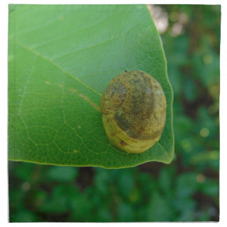Schnecke auf einem Magnolienblatt Stoffserviette