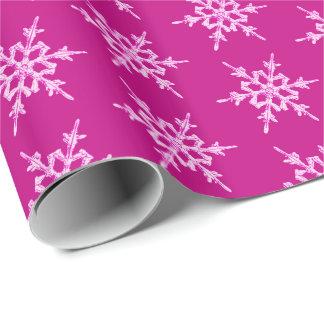 Schneeflocken, erblassen - rosa Kristalle auf Geschenkpapier