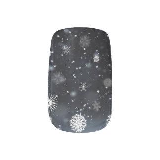 Schneeflocken in den Nachtnagel-Verpackungen Minx Nagelkunst