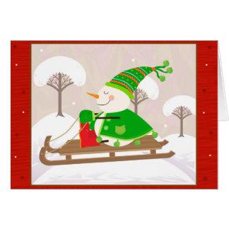Schneemann auf einem Schlitten Mitteilungskarte