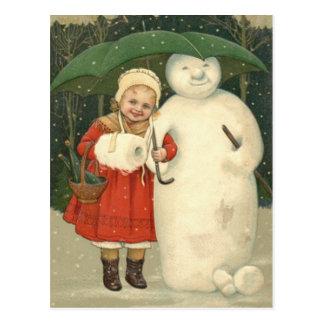 Schneemann-Mädchen-Regenschirm-Schneefälle Postkarte