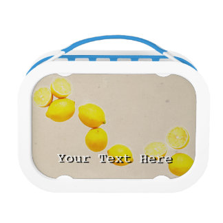 Schnur der Zitronen auf Vintagem Hintergrund Brotdose