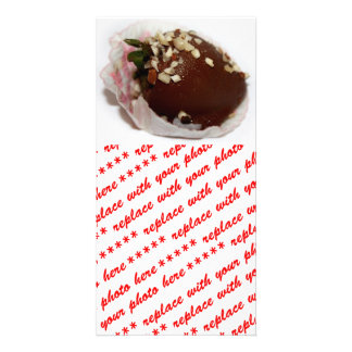 Schokolade bedeckte Erdbeere mit Nüssen Bilderkarte