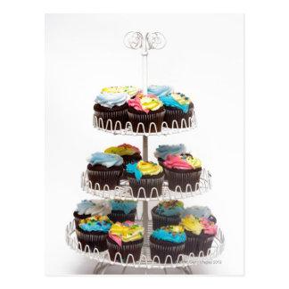 Schokoladenkleine kuchen auf einem Kuchenstand Postkarte