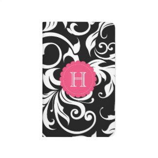 Schwarz-weißes und rosa Blumenstrudel-Monogramm Taschennotizbuch
