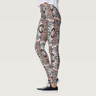 Schwarz-weißes und rötliches gemustertes leggings