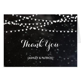 Schwarze Bokeh Schnur der Lichter danken Ihnen zu Mitteilungskarte