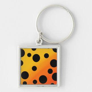 Schwarze Flecken auf gemischtem OrangeToYellow Schlüsselanhänger