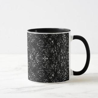 Schwarze gemusterte Tasse