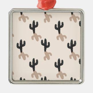 Schwarze Kakteen in der rosa Wüste Quadratisches Silberfarbenes Ornament