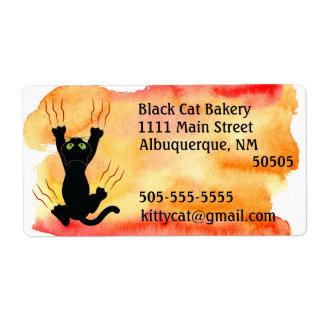 Schwarze Katze, die Aquarelladresse verkratzt