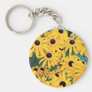 Schwarze mit Augen Susan-Blumen in dunkelgelbem Schlüsselanhänger