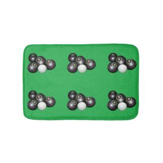 Schwarze Rasen-Schüsseln auf Grün, Badematte