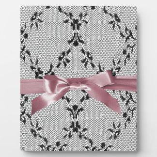 Schwarze Spitze und rosiger Knoten Fotoplatte