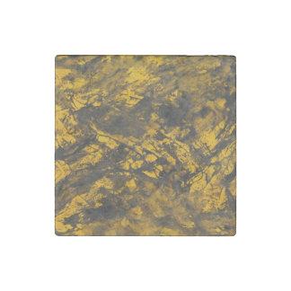 Schwarze Tinte auf gelbem Hintergrund Stein-Magnet