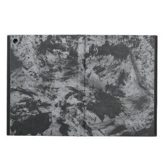 Schwarze Tinte auf grauem Hintergrund