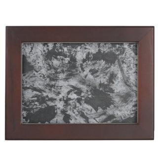 Schwarze Tinte auf grauem Hintergrund Erinnerungsdose