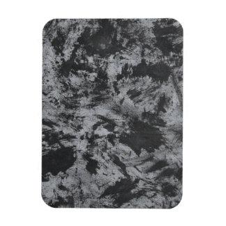 Schwarze Tinte auf grauem Hintergrund Magnet