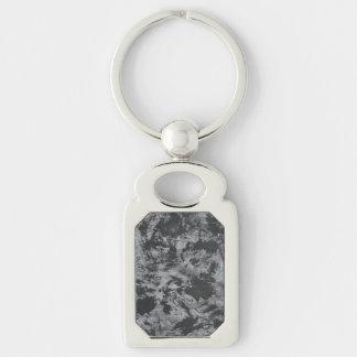 Schwarze Tinte auf grauem Hintergrund Schlüsselanhänger