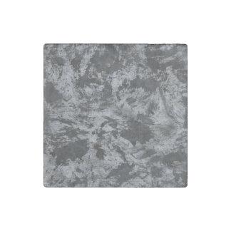 Schwarze Tinte auf grauem Hintergrund Steinmagnet