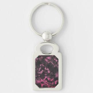 Schwarze Tinte auf rosa Hintergrund Schlüsselanhänger