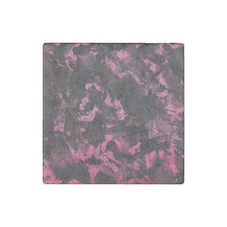 Schwarze Tinte auf rosa Hintergrund Stein-Magnet
