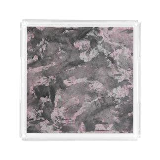 Schwarze Tinte auf rosa Leuchtmarker Acryl Tablett