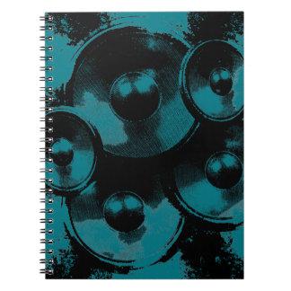 Schwarze und grüne Musik-Lautsprecher Notizblock